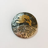 Windswept tree brooch made of  silver and bronze at vu jewellers