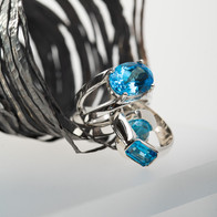 Unravel sculpture and rings