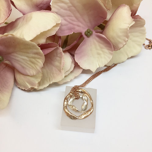 Get Knotted Double Knot Necklace in Rose Gold and Silver