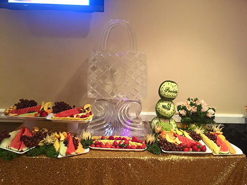 Chanel Handbag on decorative pillar with fruit and vegetable display