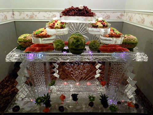 Ice bar with five tier assorted fruit platters, fruits and vegetable carvings