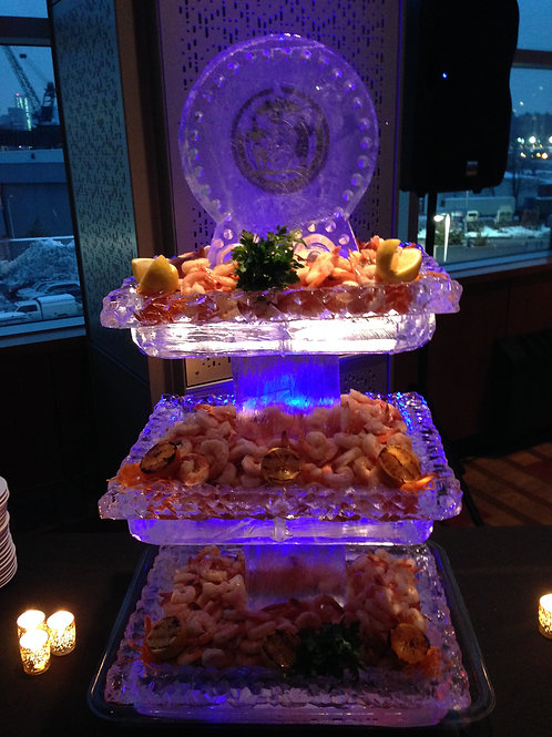 Three tier ice platters with inlay logo on top and poached shrimp cocktail