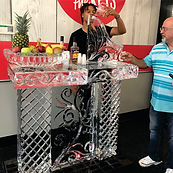 Ice bar with shot luge on top