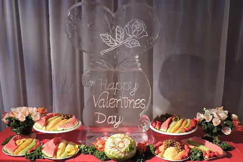 Valentines day heart with snow filled rose and scroll with fruit display