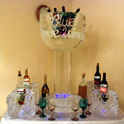 Wine glass ice sculpture with bottle holders for wine display