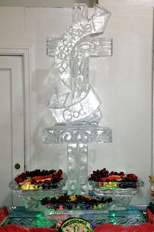 Cross with banner and three tier ice platters of assorted fruits