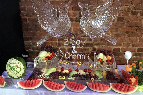 Love birds with heart, ice platters and assorted fruits