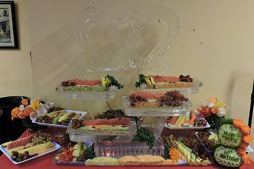 Interlocking Hearts with four tier texured rim ice platters of assorted fruits