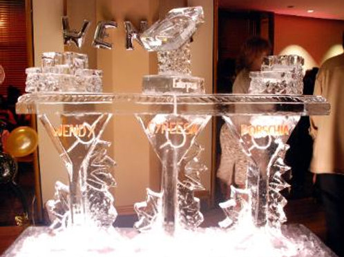 Martini glass ice bar with bottle holders and ice luge