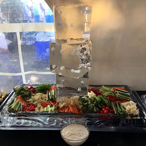 Ice sculpture with vegetable crudite and dipping sauces