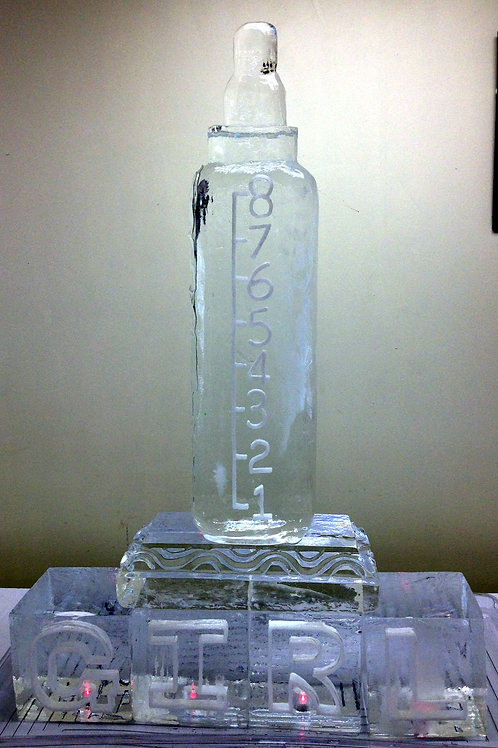 Baby Bottle on a Pedestal with Baby Blocks