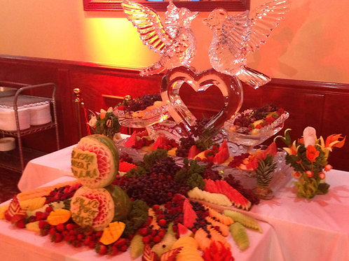 Love birds on hollowed heart with three tier ice platters and fruit display