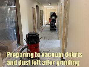 Preparing to vacuum debris and dust left after grinding