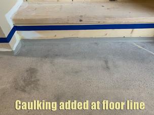 Caulking added to floor line