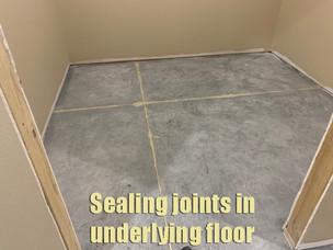 Sealing joints in underlying floor