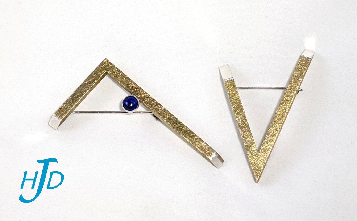 Brass and sterling silver hollow brooches with 6mm lapis lazuli, 2009