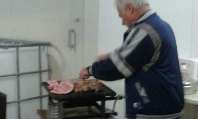 My friend Giorgos behind the grill