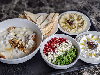 fetteh bowl, baley salad, labneh, baba ganoush