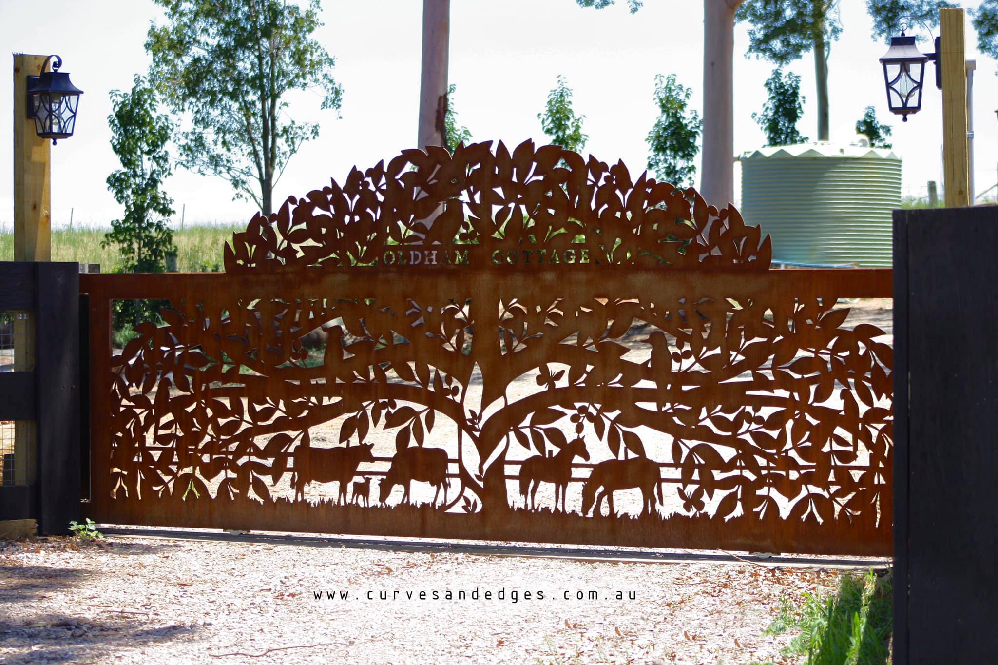 metal tree gate horses cows Curves and E