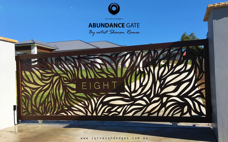 Abundance Design in a Corten Powder Coat Gate