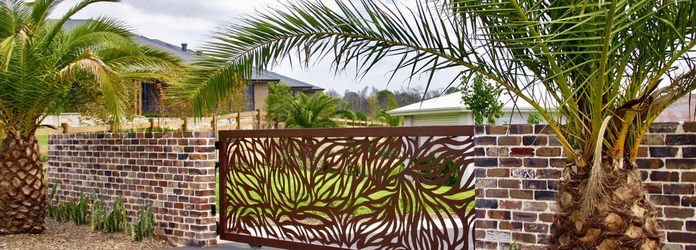 Abundance Design Gate in Corten Textured Powder Coat Finish