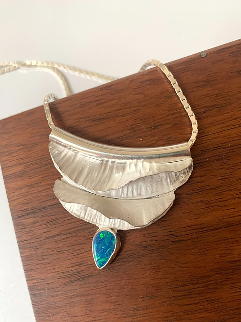 Silver fold-form necklace with opal.