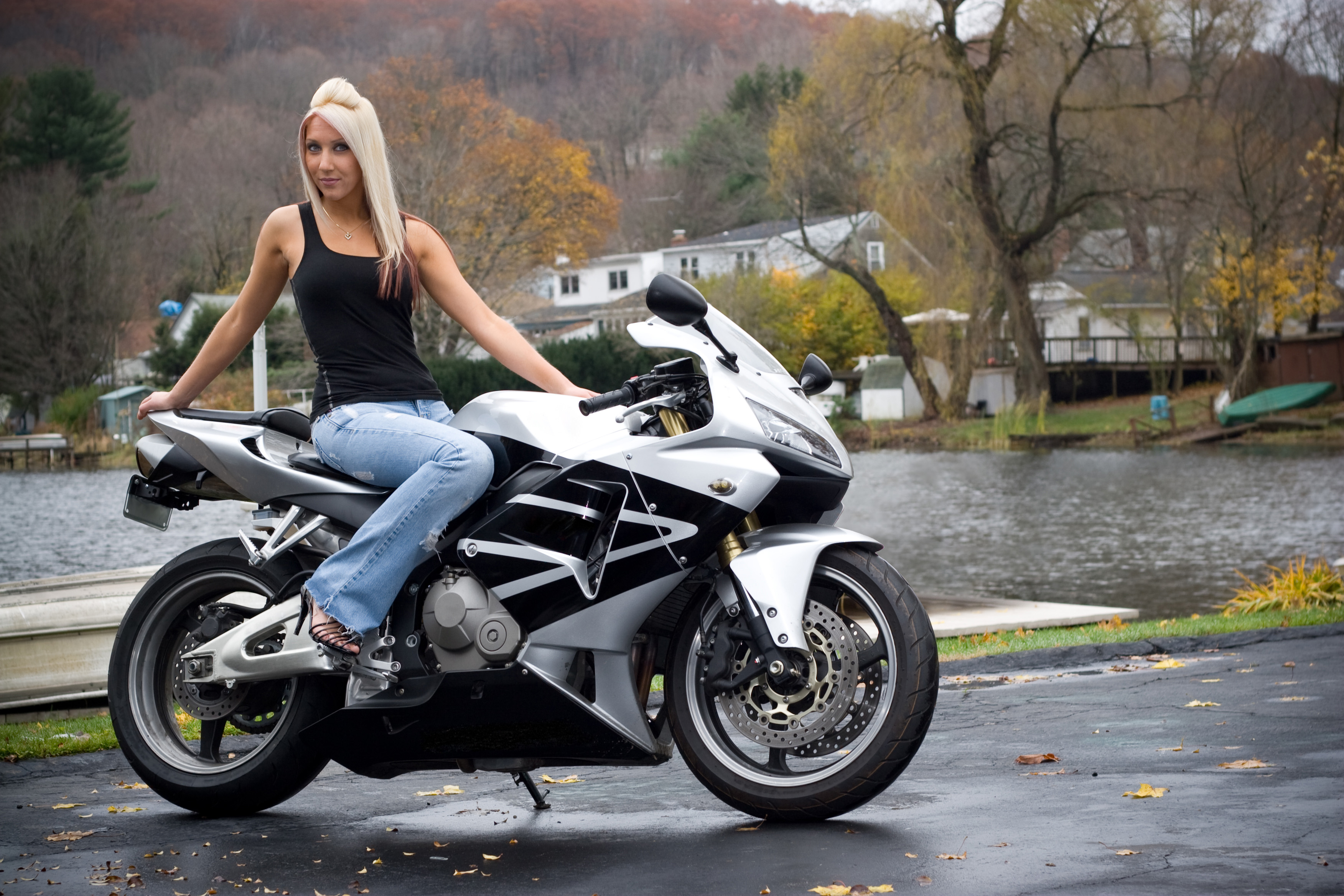 a-pretty-blonde-girl-posing-on-a-motorcy