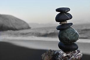 balancing stones on beach - colton sturg