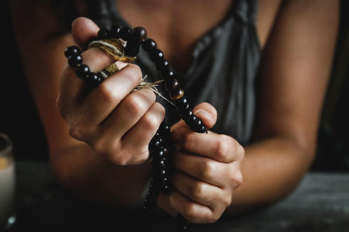 holding sacred mala beads - chelsea shap