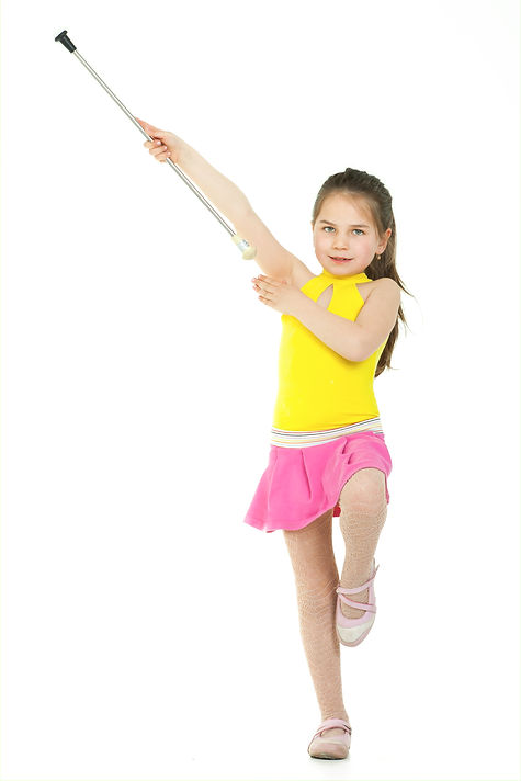 A young elementary-aged drum majorette i