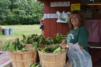 Maureen happily selling Dr. Davies Own Farm Fresh Corn