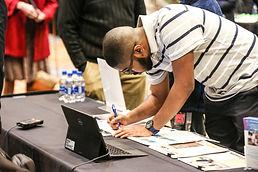 Man filling out application at last year's Job Fair