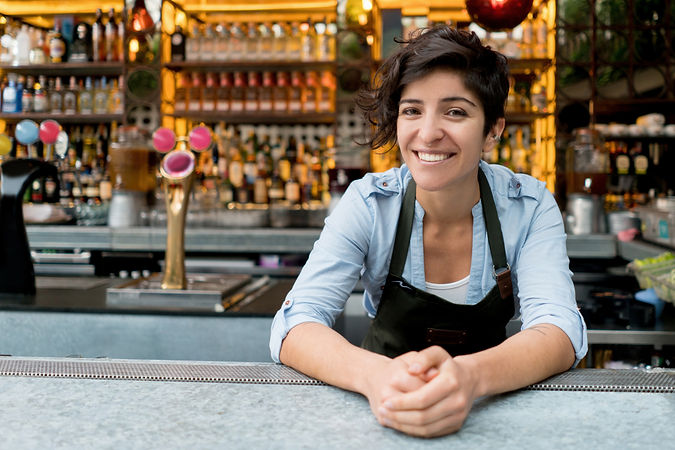 Woman working behind the counter in a restaurant