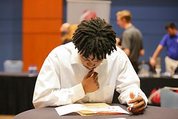 Young man filling out an application at last year's Job Fair