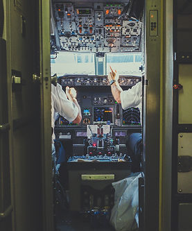 Commercial pilots in airplane cockpit
