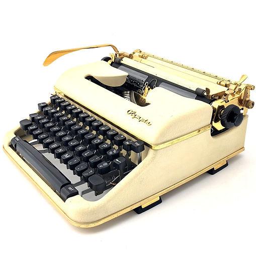 Gold Olympia Typewriter
