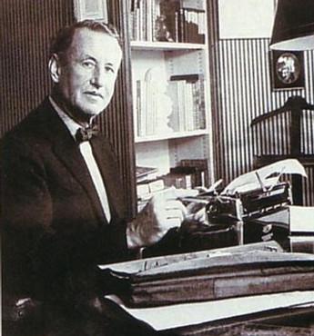 Sir Ian Fleming with a Gold Royal Typewriter