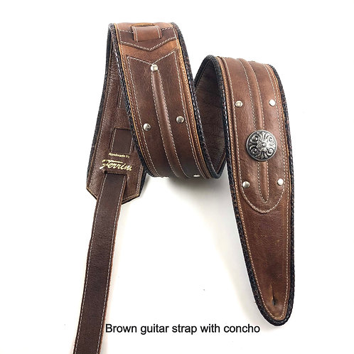 brown guitar strap with concho