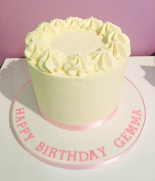 Four Layers Of Pink Champagne Sponge Filled With Ercream