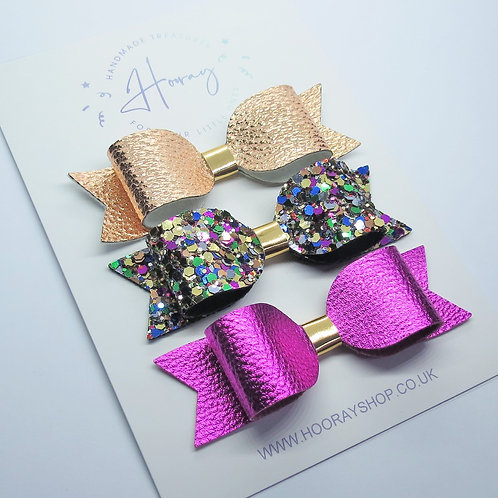 handmade gold and magenta hair bow set front view