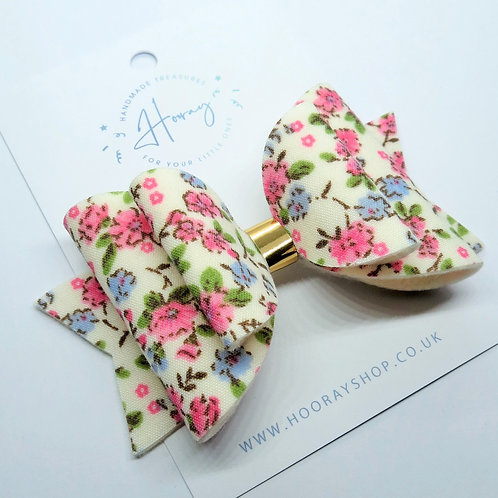 Pink floral handmade hair bow front view