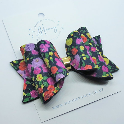 Handmade Navy blue floral hair bow front view