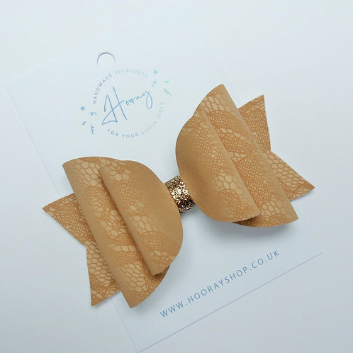 handmade faux leather nude hair bow front view