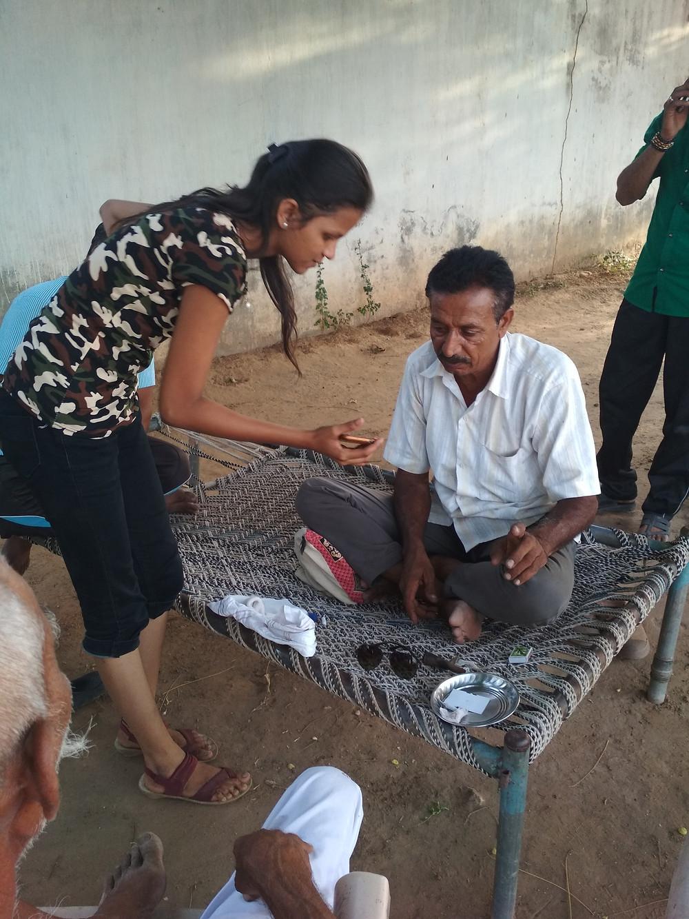 Vrushali showing electronic nilgai detection method to farmer