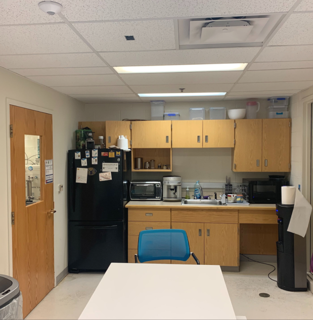 Break room - with espresso machine, water cooler, fridge, microwave, and toaster oven