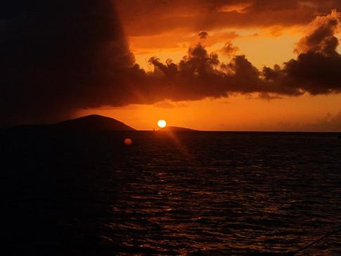 Sunset between Hans Lollik Island