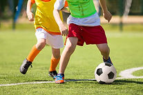 niños_jugando_futbol.jpg