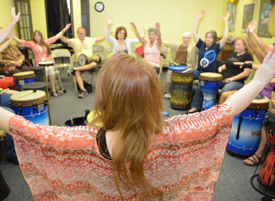Cindy St. Cyr Facilitating a Drum Circle