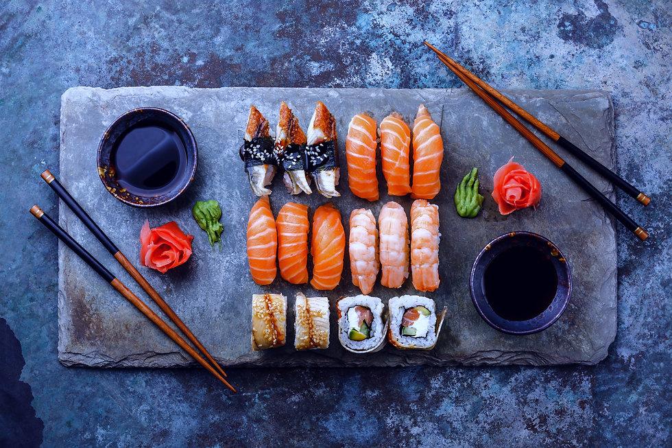 Sushi%20Set%20sashimi%20and%20sushi%20rolls%20served%20on%20stone%20slate_edited.jpg