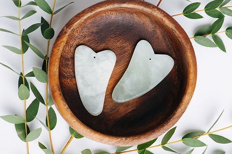 Chinese gua sha stones on a plate with e